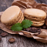 Macaroons with coffee beans Stock Photography