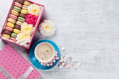 Macaroons and coffee. Sweet macarons in gift box Royalty Free Stock Photo