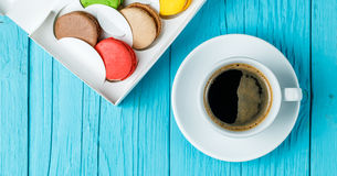 Macaroons with coffee on table Stock Photos