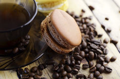 Macaroons with coffee taste. And coffee beans Royalty Free Stock Images