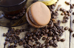 Macaroons with coffee taste. And coffee beans Stock Images