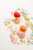 Macaroons and confetti Stock Photography