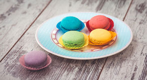 Macaroons cookies on blue plate Royalty Free Stock Images