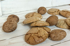 Macaroons cookies  and walnut on white wooden background Royalty Free Stock Image