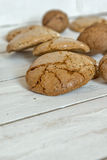 Macaroons cookies  and walnut on wooden background Stock Photo