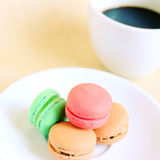 Macaroons and cup of coffee with retro filter effect Royalty Free Stock Photos