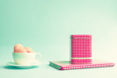 Macaroons in a cup and tea tin Stock Images