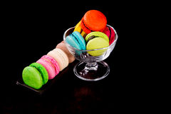 Macaroons on dark black background Royalty Free Stock Photos