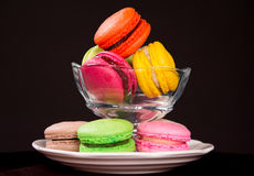 Macaroons on dark black background Stock Images
