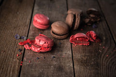 Macaroons on dark wooden background. Different kinds of macaroons. Food photo. Vintage background stock images