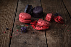 Macaroons on dark wooden background. Different kinds of macaroons. Food photo. Vintage background stock photo