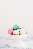 Macaroons decorated with white flowers on cake stand Royalty Free Stock Images