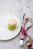Macaroons dessert  and a measuring tape Stock Photos