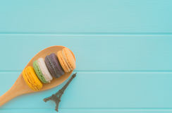 Macaroons, Eiffel Tower model, flat lay. On blue wooden background Royalty Free Stock Images