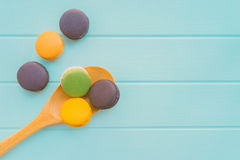 Macaroons, flat lay. On blue wooden background Stock Image