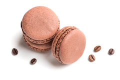 Macaroons flavored coffee on a white background Royalty Free Stock Images