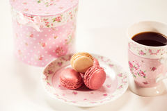 Macaroons on floral plate Stock Images