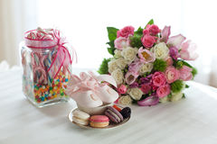 Macaroons, flowers and candy Stock Photos