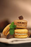 Macaroons. French macaroons macro black background Stock Photos