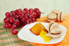 Macaroons, grapes and caramel pudding Royalty Free Stock Photography