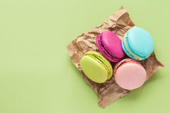 Macaroons on green pastel background with copy space. Stock Images
