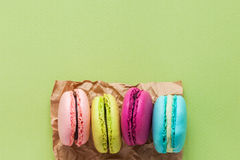 Macaroons on green pastel background with copy space. Top view, Stock Image