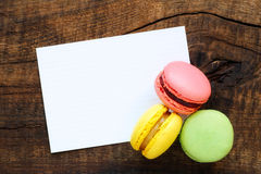Macaroons with greeting card royalty free stock photography