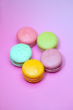 Macaroons isolated on pink Stock Photo