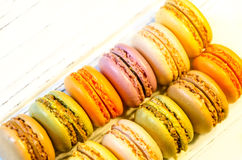 Macaroons on the light board Stock Images