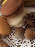 Macaroons. Macro shot of macaroons on white and wooden background Royalty Free Stock Images