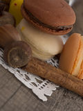 Macaroons. Macro shot of macaroons on white and wooden background Stock Image