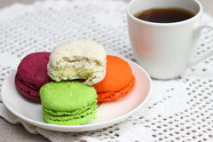Macaroons. A miniature Eiffel tower and bright macaroons. Shallow DOF royalty free stock photography