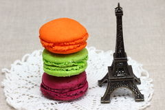 Macaroons. A miniature Eiffel tower and bright macaroons. Shallow DOF royalty free stock photos