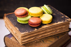 Free Macaroons On Book Royalty Free Stock Image - 65405696