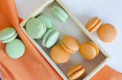 Macaroons. Orange and green apple macaroons Royalty Free Stock Photography