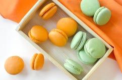 Macaroons. Orange and green apple macaroons Stock Image
