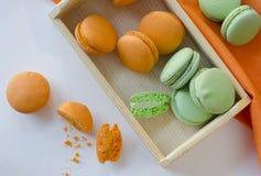 Macaroons. Orange and green apple macaroons Royalty Free Stock Image