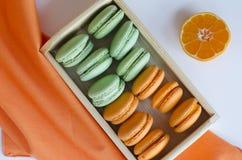 Macaroons. Orange and green apple macaroons Royalty Free Stock Photos