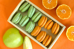 Macaroons. Orange and green apple macaroons Royalty Free Stock Images