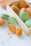 Macaroons. Orange and green apple macaroons Stock Photography
