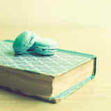 Macaroons over book Royalty Free Stock Photography