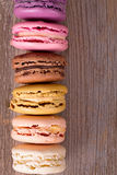 Macaroons over old wood Royalty Free Stock Photography