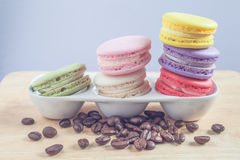 Macaroons and roasted coffee Stock Image