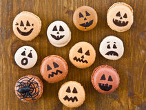 Macaroons with scary faces Royalty Free Stock Photography