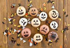 Macaroons with scary faces. Macaroons with scary and funny faces for Halloween Stock Images