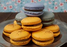 Macaroons served on a silver plate Stock Photos