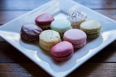 Macaroons Served on White Ceramic Plate Royalty Free Stock Photos