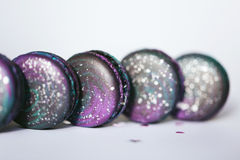 Macaroons with space pattern in a row Stock Photography