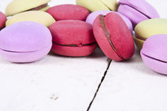 Macaroons. Stacked on white wooden background, cupcakes Stock Photos