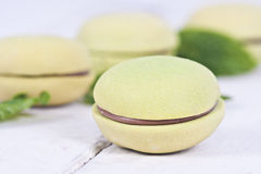 Macaroons. Stacked on white wooden background, cupcakes Royalty Free Stock Images